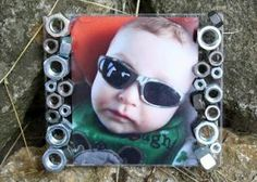 Use hardware pieces like washers and nuts to make a unique picture frame for the handyman in your home this Father's Day!