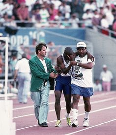 Derek Redmon  Track and Field 1992  Father helped him finish after Achilles tendon injury