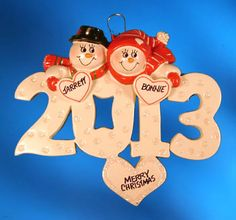Personalized 2013 Snow Couple Christmas Ornament with Heart image from Ornaments with Love!