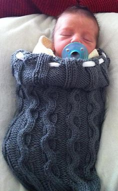 Free Knitting Pattern for Cable Swaddler - Baby cocoon sleep slack with an all over cable pattern in worsted yarn. Designed byTiara Shanafelt