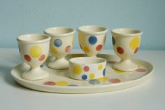 SMF Schramberger Majolika Fabrik egg cups and small salt cellar on a plate, design by Eva Zeisel 1928-29 West Germany