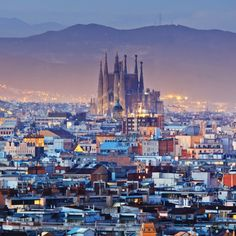 BARCELONA, SPAIN. Sagrada familia is not taller then the mountain ( hill really) guadi wanted gods creation to be taller then his to show deference.