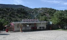 Sugar's, Embudo, NM. On the road from Santa Fe to Taos. Green chile cheeseburgers and Fritos Pie, but ALSO highly recommended BBQ. Roadfood recommended.