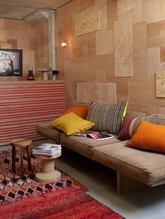 Wouldn't it be cool if a room had all cork walks? Or one cork wall? Then you could pin up whatever you wanted ;)  I don't think this is cork in the picture but the wooden walls inspired me