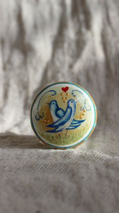 Lovely hand painted dresser knobs.    Love birds are painted on to a rustic setting.  A little red heart completes the design.    Unique