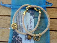 leather:sand, gold charms! stellas art