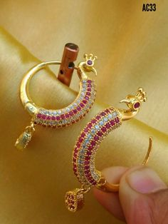 Shipping free with cod facility Beautiful Rajwadi Stylish Earrings Color : Golden Material : Alloy Best collection of stylish trendy earrings design. Very much stylish and rich look appearance for women. Indian Jewelry Earrings, Buy Earrings, Jewelry Design Earrings, Gold Earrings Designs, Gold Jewellery Design, Jhumka Designs, Peacock Earrings, Nose Jewelry, Mehndi Designs