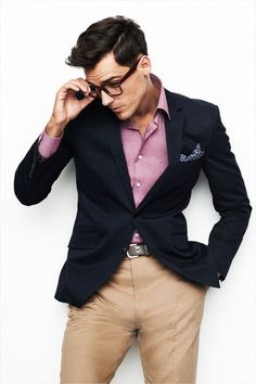 blue blazer, khaki pants, and light red shirt