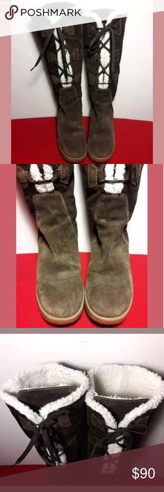 Michael Kors Leathrr Suede Boots Size 7.5 Michael Kors  Here we have an Amazing pair of Pre-Loved Michael Kors Leather Boots with a Suede feel. Tall in Length Wedge Heel, Inside Sherpa lining for warmth, Pull on Lace up & Tie front. Women's Size 7.5.  Pre-owned in Excellent condition.  Minor unnoticeable flaws from light wear.  Please be sure to view all images.  Thank you for Looking & Sharing Happy Poshing😄 Michael Kors Shoes