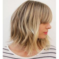 Stylist: Liz SustaitaSalon: Ramirez | TranWhat to ask for: An A-line, undercut bob with bangs