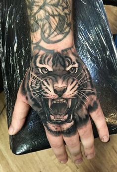 How much does a hand tattoo hurt? We have hand tattoo ideas, designs, pain placement, and we have costs and prices of the tattoo. Black Tiger Tattoo, Tiger Hand Tattoo, Japanese Tiger Tattoo, Tiger Tattoo Design, Full Arm Tattoos, Hand Tattoos For Guys, Body Art Tattoos, New Tattoos, Sleeve Tattoos
