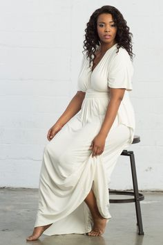 Our plus size White Jasmine Indie Flair Maxi Dress will make you look like a goddess with its kimono sleeves and draped front. Browse our made in the USA styles at www.kiyonna.com. #kiyonna #plussize #whitedress