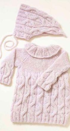 Cabled Dress & Bonnet Baby Knitting Pattern Free by Viking of Norway. Skill Level: Intermediate Matching bonnet and dress set with a stunning cabled stitch for infants. Toddler Sweater Dress, Girls Knitted Dress, Knit Baby Dress, Knitted Baby Clothes, Toddler Dress, Baby Knits, Smock Dress, Cute Baby Dresses, Smocked Baby Dresses
