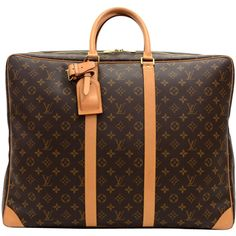 Pre-Owned Louis Vuitton Sirius 55 Monogram Canvas Travel Bag (1,390 CAD) ❤ liked on Polyvore featuring bags, brown, multi coloured bags, canvas travel bag, monogram canvas bag, monogrammed travel bags and colorful bags