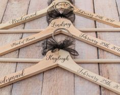 I love this idea! Hang the wedding dresses on personalized hangers!