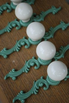 drawer knobs - I wonder if I could make something similar with standard knobs and those wooden decorative things you can buy