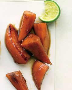 Glazed Sweet Potatoes with Brown Sugar and Lime-  1 tablespoon vegetable oil, such as safflower   2 pounds sweet potatoes,  1 cup chicken broth or water   1/2 cup packed brown sugar   2 tablespoons fresh lime juice   2 tablespoons unsalted butter   1/4 teaspoon cayenne pepper