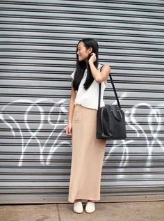 good peachy beige with white and a heavy black handbag