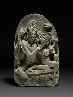 seated Shiva in amorous dalliance with Parvati, seated on his knee 10th C.The British Museum