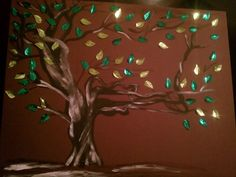 Metal Green leaves with an oil paint tree. I enjoyed doing this project.