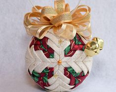 Quilted Noel Ornament - Christmas ornament - Beige with gold sparkle fabric with alternating burgundy fabric, gold bow, and two gold bells