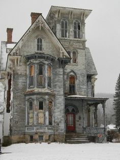 I just love these beautiful old houses.  The architecture is amazing.  Sad to see the disrepair.