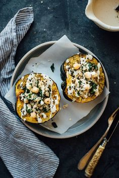 Don't miss this recipe for Stuffed Za'atar-Roasted Acorn Squash With Pepper-Lemon Tahini Sauce! The Middle Eastern spin on stuffed squash with help from za'atar and zesty lemon-spiked tahini makes for a delicious vegan side dish. Kale Recipes, Baby Food Recipes, Vegetarian Recipes, Cooking Recipes, Healthy Recipes, Healthy Foods, Pumpkin Recipes, Zatar Recipes, Recipes Dinner
