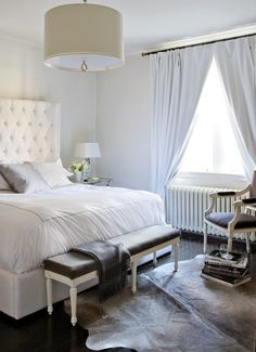 Luxurious White Bedroom with Tall Tufted Headboard and Oversized Pendant (bedding, shams, Au Lit; night table, chandelier, rug, throw, throw pillow, Elte; lamp, HorseFeathersHome; bed, chair, bench, curtains, Ferreira Design) - by Jennifer Ferreira in Canadian House & Home Aug 09
