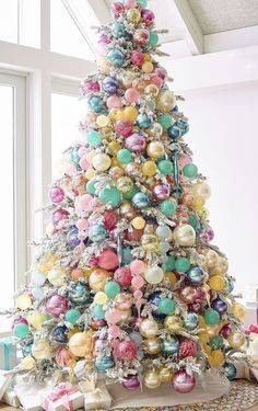 White Christmas tree with pastel ornaments. Expecting a baby near Christmas time? This tree would make a beautiful focal point for your shower decor and a pretty tree for baby's arrival. Kids love this fun and colourful tree! Christmas Tree Decoration Ideas 2018, Christmas Tree Themes, Noel Christmas, Pink Christmas, Christmas Candy, All Things Christmas, Christmas 2019, Christmas Cactus, Christmas Lights