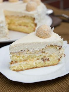 Just like its sibling Ferrero Rocher Cake, this cake doesn't lack in creative description. If you've ever had tried Raffaello Chocolates, you will recognize this cake immediately. It's moist, and tastes like candy with every bite. With the flaky snow-ish coconuts on the outside, this cake is perfect for winter. P.S. The candy in the recipe were also made, and boy are they finger-licking delicious! Watch out for that recipe, it's coming up soon!