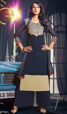 Classic beige and navy blue georgette palazzo suit is perfect for evening party requirement. The straight cut suit is embellished with round neckline with contrast piping, contrast red lace, silk thread embroidered upper bodice and sleeves and crystal stones which adds charm and grace to your beauty. The suit comes with matching dupatta and palazzo. #GeorgetteCasualDresses