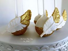 gold tipped feathers cake pops