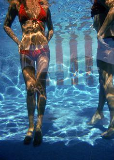 cherry red bikini/ Pool at Las Brisas, by Slim Aarons. 1972.