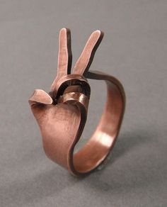 peace sign ring.  cute, but I can't help but think of one giving people the finger! Oh! I'm so bad! bwahaha!