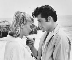 """kelseyevers's media  Sandy and Danny in Grease. Best couple to ever croon a tune in a musical about the fifties. John Travolta and Oliva Newton John burn up the screen with their sweet love. She sang that she was """"hopelessly devoted to him"""" and he sang about """"summer loving"""" and """"greased lightning"""" but inbetween, he tried to get into her panties and she held him off, but their love was genuine. How else can a couple end happily? """"We go together"""" made Danny and Sandy one of the best movie…"""