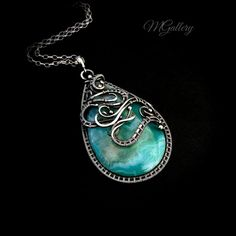 Silver pendant with agate wire wrapping. by GaleriaM on Etsy