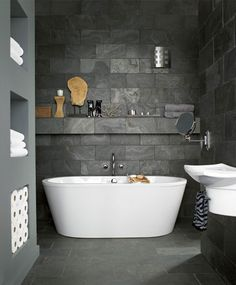 Love everything! Dark Tile against white tub, invisible shelf, clean lines of the storage cubbies built in
