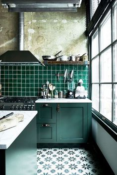 Kitchen Interior Design Industrial chic kitchen with green kitchen cabinets and green square tiles - There's one look our editors agree isn't going anywhere: industrial design. Here's how to re-create the hip loft look and warehouse style at home. Industrial Chic Kitchen, Rustic Kitchen, New Kitchen, Vintage Kitchen, Industrial Design, Vintage Industrial, Kitchen Ideas In Green, Rustic Design, Green Kitchen Designs