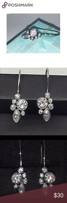 Platinum Plated Crystal Cluster Earrings NWT Platinum Plated Crystal Cluster Earrings NWT:  these are absolutely gorgeous, and just the right size to make a statement.  Very classy. Jewelry Earrings