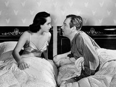 Merle Oberon and Melvin Douglas in a movie in which censors required twin beds.