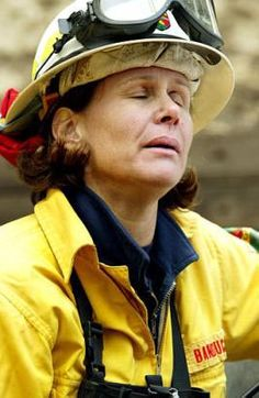 Woman firefighter taking a time out from fighting forest fires out west.
