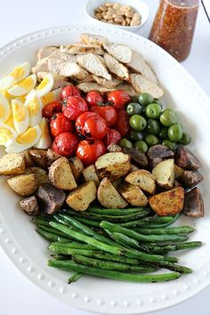 The classic French Nicoise salad gets an American BBQ twist via grilled chicken, potatoes, green beans & tomatoes and a sweet, tangy maple-mustard dressing.