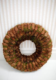 This wreath is decorated with pine cones and moss.  External diameter- 33 cm (13) Internal diameter- 11 cm (4.3) Thickness- 6 cm (2.4)  This wreath is perfect all year long!  The wreath will be carefully packed for shipping. If you have any further questions feel free to contact me.  Happy Holidays and best wishes