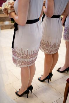 Black sashes and shoes offset these light & sparkly bridesmaid dresses.