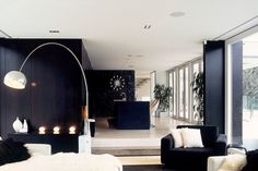 Whites Road is a private residence that is located in Whitford, Auckland, New Zealand and was designed by Dorrington Architects & Associates. The interior is designed in a sophisticated palette of deep darks and bright lights, drawing from the stark contrast between the two to add atmosphere and elegance.