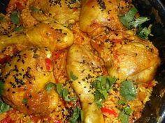 La meilleure recette de Poulet au riz épicé! L'essayer, c'est l'adopter! 5.0/5 (7 votes), 16 Commentaires. Ingrédients: 740 gr de pilons et hauts de cuisses de poulet, un citron, 125 gr de riz,3 oignons, 2 gousses d ail,une demi boite de pulpe de tomates,un sachet de safran en filament,curcuma,coriandre en poudre, cumin en poudre,parika,un piment rouge, une cas de nigelle ou de sumac, huile d olive, thym, 30 cl de bouillon de volaille,sel,poivre,pluches de coriandre