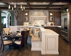 Love the use of space with bench seating and still open kitchen!