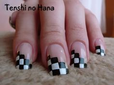 Diagonal checkerboard nails by Teshi no Hana...perfect for crossword or NASCAR fans! See more pictures of these awesome nails here (page is in French): http://www.nails-art.fr/article-echec-45278710.html