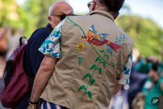 Men wearing a shirt with a bird print on a street style photo taken during Pitti Uomo.
