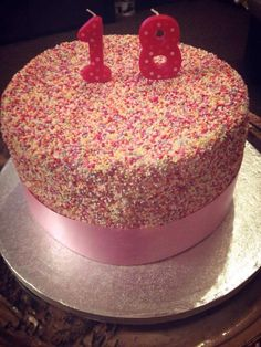 A three layer cake covered with vanilla buttercream and sprinkles. A very messy cake to prepare, but worth it for my best friends 18th birthday party.